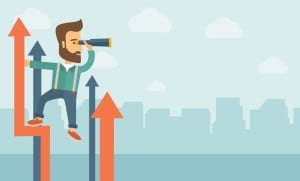 A businessman with beard stand on top of graph arrow using his t